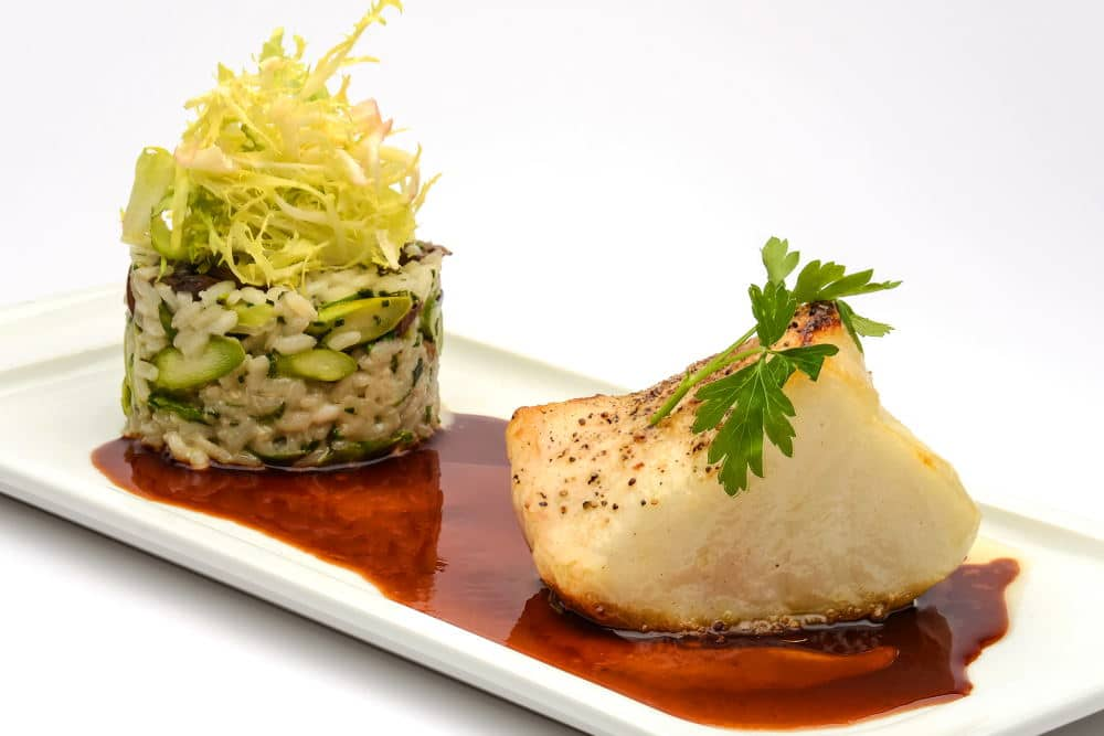 Food Photography of an elegant Halibut plate